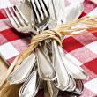 Collection of forks and knifes tied together — Stock Photo #10271415