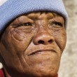 Stock Photo: Old African woman against a grunge background