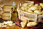 Still life of potatoes in a basket — Stock Photo