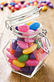 Colorful jelly beans in a bottle - very shallow depth of field — Stock Photo