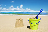 Toy bucket and shovel on the beach — Stok fotoğraf