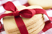 Heart shape cookies with red ribbon — Stock Photo