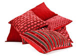 Red cushions stacked up on a white background — Stock Photo