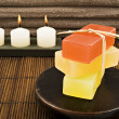 Soap candles and towels in a spa — Stok fotoğraf
