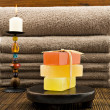 Soap candles and towels in a spa — Photo