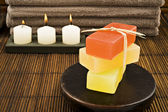Soap candles and towels in a spa — Stock Photo