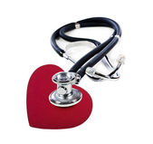 A Doctor's stethoscope listening to a red heart — Stock Photo