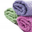 Fresh rolled up towels on a white background — Stock Photo #10372400