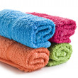 Fresh rolled up towels on a white background — Stock Photo