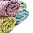 Fresh rolled up towels on a white background — Stock Photo #10372451