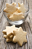 Sugar coated shortbread cookies in star shapes — Stock Photo