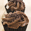 Lovely fresh chocolate cupcakes - very shallow depth of field — Stock Photo #10381389