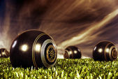 Close up of bowling balls on an open bowling field at sunset — Foto de Stock