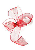 Red ribbon bow on a white background — Stock Photo