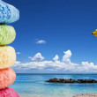 Royalty-Free Stock Photo: Colorful towels and a fruit cocktail on the beach