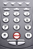 Keypad of a telephone with a red button for help — Stock Photo