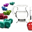 Healthy lifestyle - water in a pitcher and glass apple with dumbbells — Stock Photo