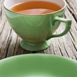 Stock Photo: Two antiques cups with tea