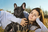Beautiful woman with a dog — Stock Photo