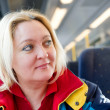 Happy woman in a train — Stock Photo #9554921