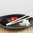 Stock Photo: Dish with white and black rise and sweet pepper on bamboo table cloth