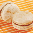 Two macaroons on a bamboo table cloth — Stock Photo