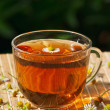Stock Photo: Cup of herbal tea and chamomile