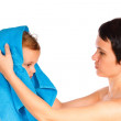 Mother wipes head to his son after bathing on a white background — ストック写真