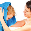 Mother wipes head to his son after bathing on a white background — Stockfoto