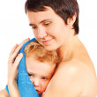 Mother wipes head to his son after bathing on a white background — Stock Photo #8462296