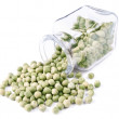 Green peas scattered on a white background — Stock Photo #10425153