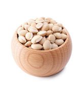 Wooden bowl full of val beans isolated on white — Stock Photo