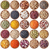 Collection of wooden bowls with legumes — Stockfoto