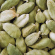 Green cardamom seeds background — Stock Photo #8600352