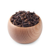 Wooden bowl full of cloves isolated on white — Stock Photo