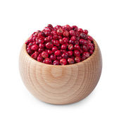 Wooden bowl full of pink pepper isolated on white — Stock Photo