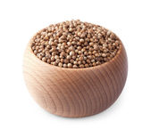 Wooden bowl full of coriander seeds isolated on white — Stock Photo