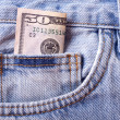 Stock Photo: Background with blue jeans pocket with money