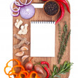 Notebook for recipes and spices on wooden cutting board — Stock Photo