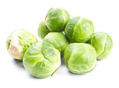 Fresh green Brussels sprouts isolated on white — Stock Photo