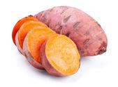 Sweet potato with slices isolated on white — Stock Photo
