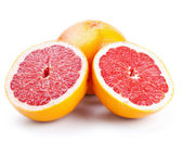 Grapefruit with slices isolated on white — Stock Photo