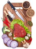 Culinary background with fresh vegetables on cutting board — Stock Photo