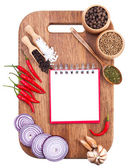 Open notebook and fresh vegetables on an old wooden cutting boar — Stock Photo