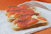 3 sandwiches with salmon — Stock Photo