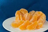 Several tangerines on white plate — Stock Photo