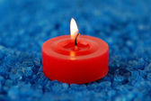 Candle on the spa salt — Stock Photo