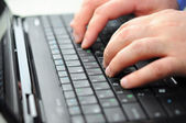 Typing on a laptop — Stockfoto