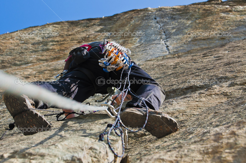 Climber while climbing a vertical rock wall  Stock Photo #8252430
