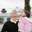 Father and daughter happy looking up outdoors — Stock Photo #10619033
